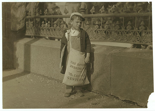 Boy age 5 or 6 selling Saturday Evening Post in Sacramento, 1915