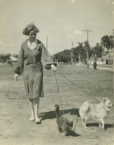Proto-hipster walks her dog and cat.