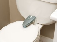 The Safety 1st pro-grade. push-button toilet lock. (Good luck to any guests visiting!)