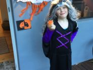 girl eating unwrapped halloween cookie