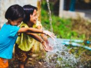 unsplash kids playing with water @akeenster