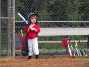 adobe toddler in little league with bat