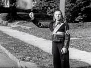 A crossing guard in 1938, when kids, not adults, shepherded students across the street.