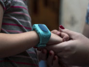 adobe child gps mom holding kids arm with gps bracelet
