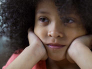 Lonely sad mulatto girl looking straight, thinking about friends, face closeup
