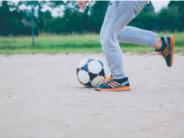unsplash ball being kicked