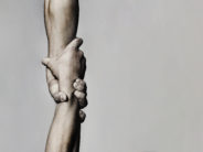 Helping hand concept and international day of peace, support. Helping hand outstretched, isolated arm, salvation. Close up help hand. Two hands, helping arm of a friend, teamwork. Black and white.