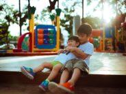 kids playing on merry go round Photo by Hisu lee on Unsplash