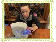 boy sewing mask