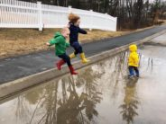 kids about to leap into big puddle diane murray