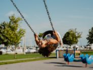 unsplash girl upside down in swing