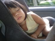 girl asleep carseat royalty free