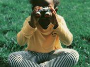 unsplash af am girl with binoculars