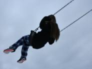 unsplash kid on swing in air noah sillman